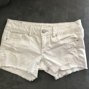 AE distressed white shorts mid rise